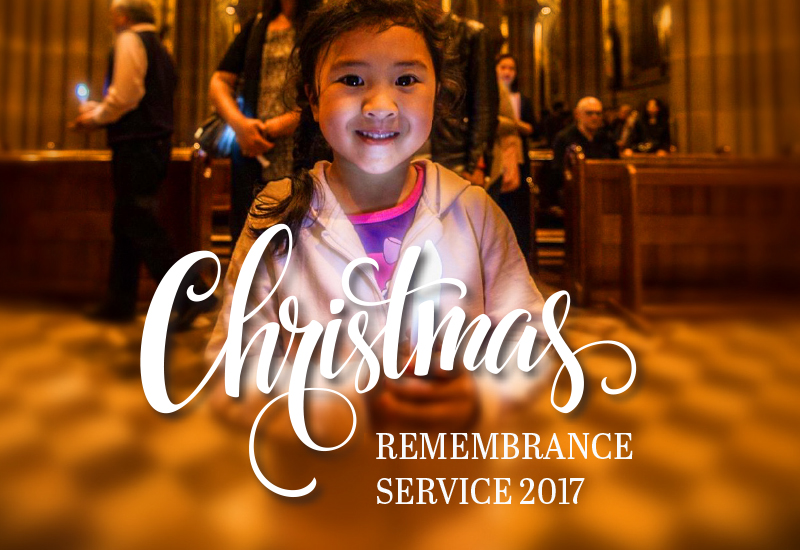 Young girl at Christmas remembrance service
